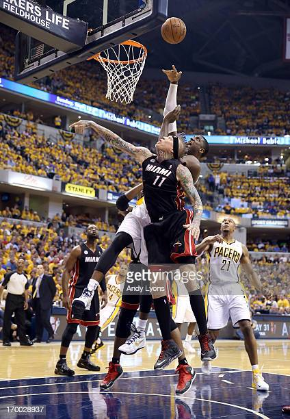 Roy Hibbert of the Indiana Pacers attempts a shot against the Chris Andersen of the Miami Heat during Game Four of the Eastern Conference Finals of...