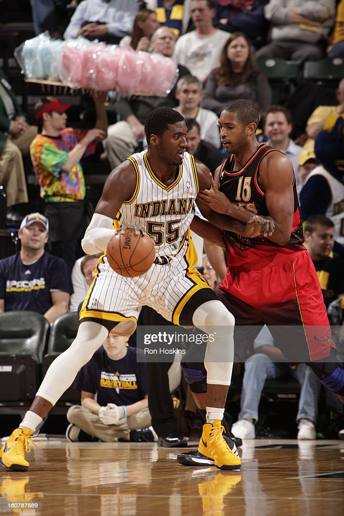 Roy Hibbert #55 of the Indiana Pacers backs up to the basket while dribbling the ball against Al Horford #15 of the Atlanta Hawks on February 5, 2013 at Bankers Life Fieldhouse in Indianapolis, Indiana.