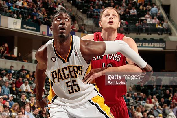 Roy Hibbert of the Indiana Pacers boxes out Rasho Nesterovic of the Toronto Raptors during the game on February 2 2010 at Conseco Fieldhouse in...