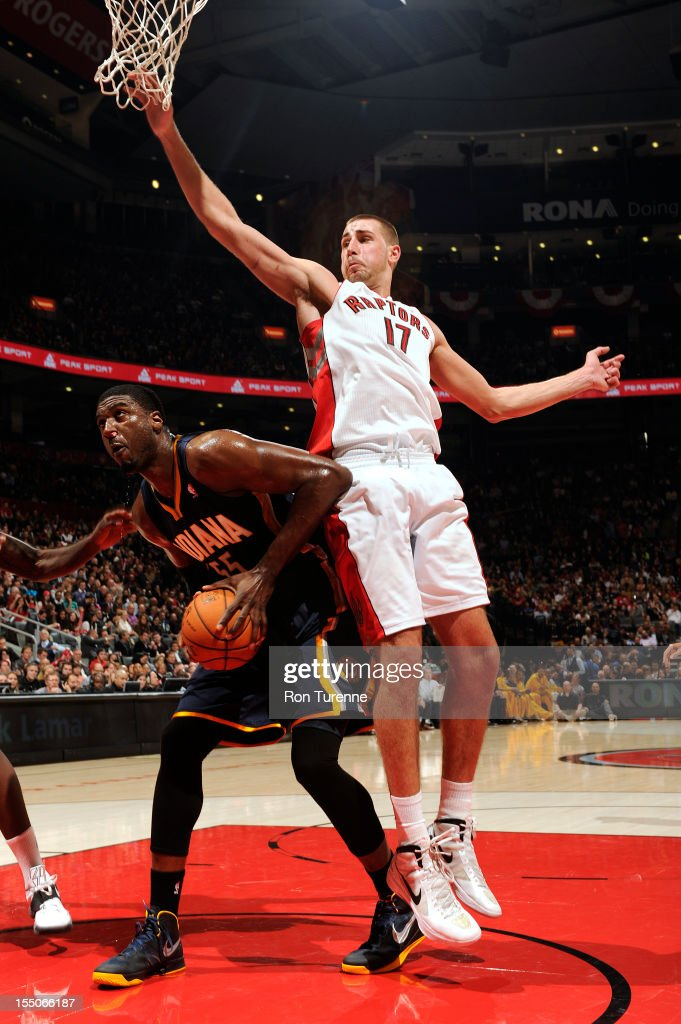 Roy Hibbert #55 of the Indiana Pacers fakes a shot against Jonas Valanciunas #17 of the Toronto Raptors on October 31, 2012 at the Air Canada Centre in Toronto, Ontario, Canada.