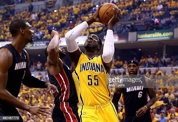 Roy Hibbert of the Indiana Pacers goes to the basket as Dwyane Wade and Chris Bosh of the Miami Heat defend during Game Two of the Eastern Conference...