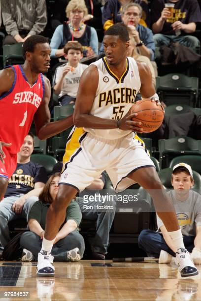 Roy Hibbert of the Indiana Pacers handles the ball against Samuel Dalembert of the Philadelphia 76ers during the game on March 9 2010 at Conseco...