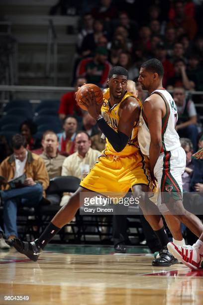 Roy Hibbert of the Indiana Pacers looks to make a move against Kurt Thomas of the Milwaukee Bucks during the game at the Bradley Center on March 14...