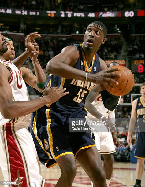 Roy Hibbert of the Indiana Pacers prepares to go up for the basket against Leon Powe of the Cleveland Cavaliers on April 9 2010 at The Quicken Loans...