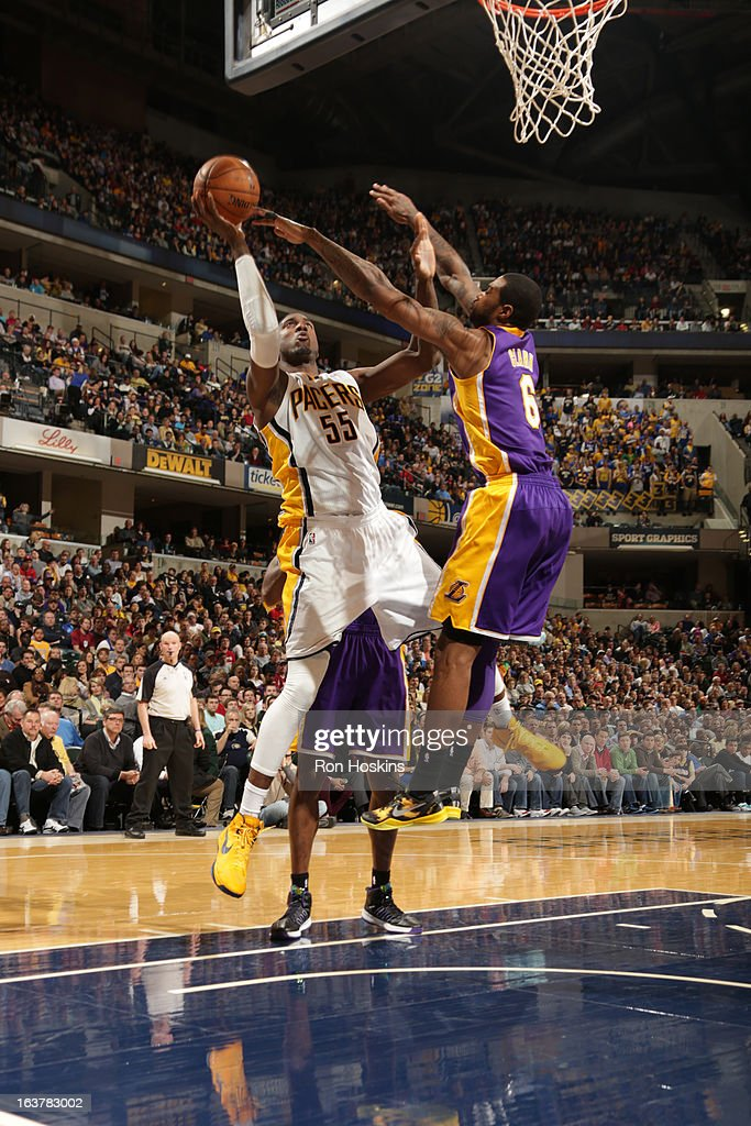 Roy Hibbert #55 of the Indiana Pacers shoots against Earl Clark #6 of the Los Angeles Lakers on March 15, 2013 at Bankers Life Fieldhouse in Indianapolis, Indiana.
