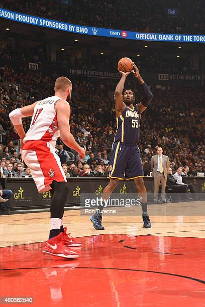 Roy Hibbert of the Indiana Pacers shoots against Jonas Valanciunas of the Toronto Raptorsduring the game on December 12 2014 at Air Canada Centre in...
