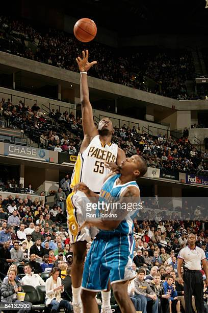 Roy Hibbert of the Indiana Pacers shoots over David West of the New Orleans Hornets at Conseco Fieldhouse on December 28 2008 in Indianapolis Indiana...