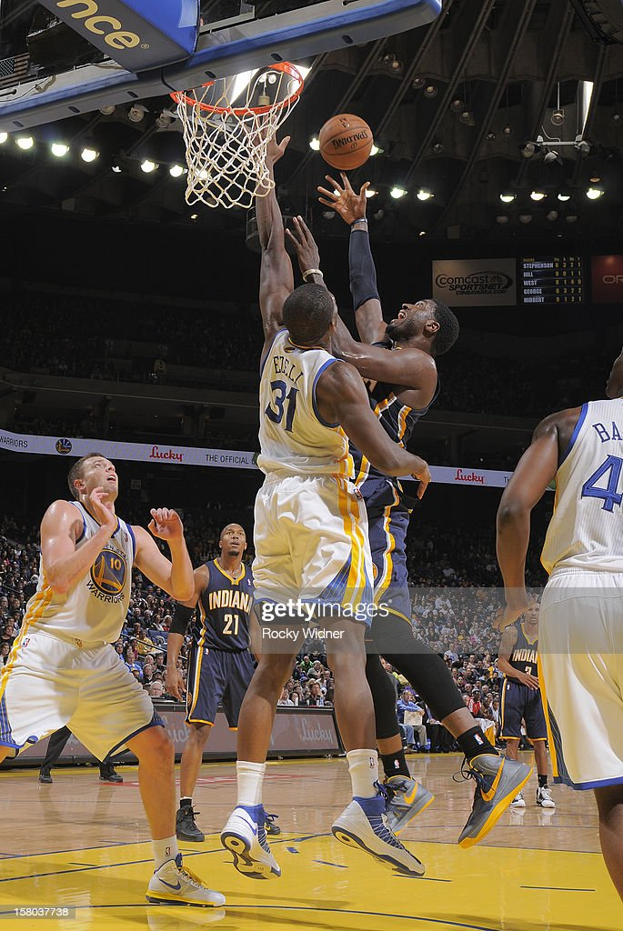 Roy Hibbert #55 of the Indiana Pacers shoots over Festus Ezeli #31 of the Golden State Warriors on December 1, 2012 at Oracle Arena in Oakland, California.
