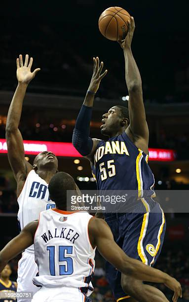 Roy Hibbert of the Indiana Pacers shoots over teammates DeSagana Diop of the Charlotte Bobcats and Kemba Walker during their game at Time Warner...