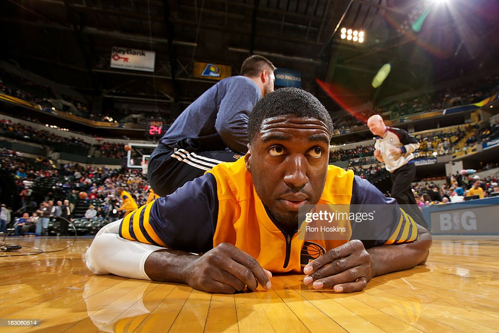 Roy Hibbert #55 of the Indiana Pacers stretches with a trainer before a game against the Chicago Bulls on March 3, 2013 at Bankers Life Fieldhouse in Indianapolis, Indiana.