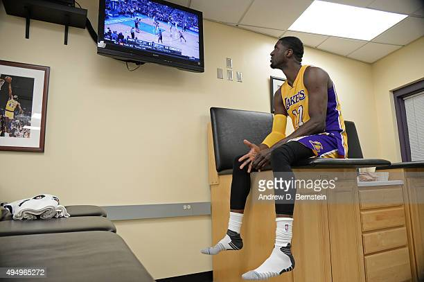 Roy Hibbert of the Los Angeles Lakers watches an NBA game on TV before the game against the Minnesota Timberwolves on October 28 2015 at STAPLES...