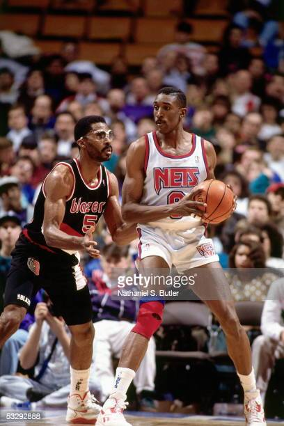 Roy Hinson of the New Jersey Nets posts up against the Portland Trail Blazers during an NBA game at the Brendan Byrne Arena circa 1991 in East...
