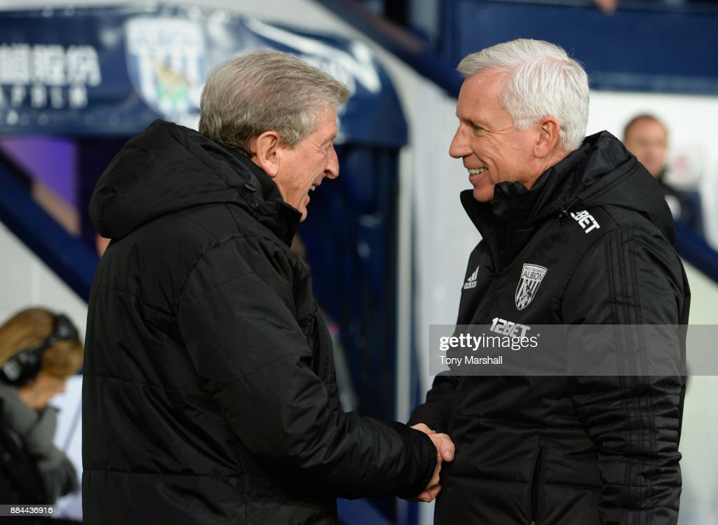 Roy Hodgson, Manager of Crystal Palace and Alan Pardew, Manager of West Bromwich Albion embrace prior to the Premier League match between West Bromwich Albion and Crystal Palace at The Hawthorns on December 2, 2017 in West Bromwich, England.
