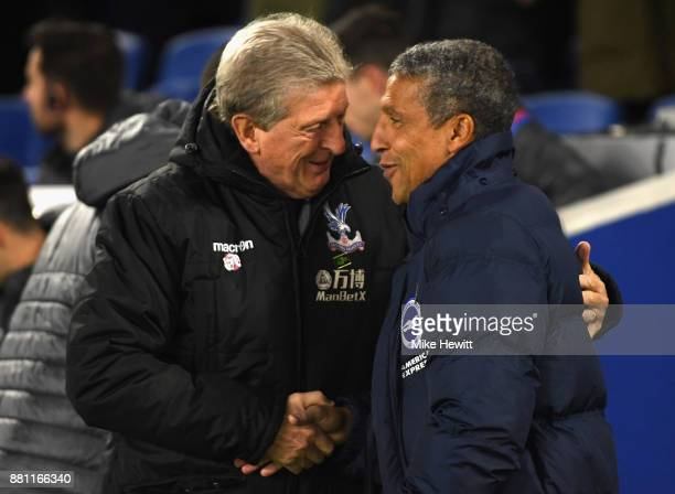 Roy Hodgson Manager of Crystal Palace and Chris Hughton Manager of Brighton and Hove Albion shake hands during the Premier League match between...