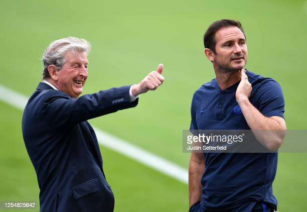 Roy Hodgson, Manager of Crystal Palace and Frank Lampard, Manager of Chelsea speak prior t the Premier League match between Crystal Palace and...