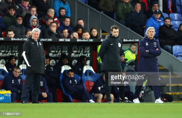 Roy Hodgson Manager of Crystal Palace and Manuel Pellegrini Manager of West Ham United look on during the Premier League match between Crystal Palace...