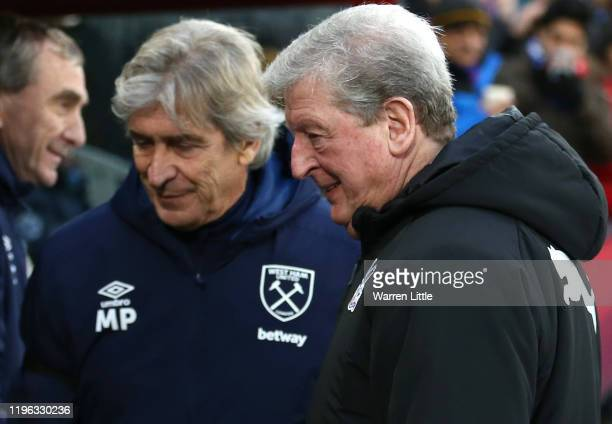 Roy Hodgson Manager of Crystal Palace and Manuel Pellegrini manager of West Ham United chat ahead of the Premier League match between Crystal Palace...