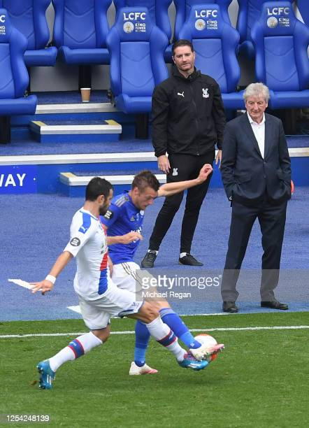 Roy Hodgson Manager of Crystal Palace looks on as Luka Milivojevic of Crystal Palace and Jamie Vardy of Leicester City battle for the ball during the...