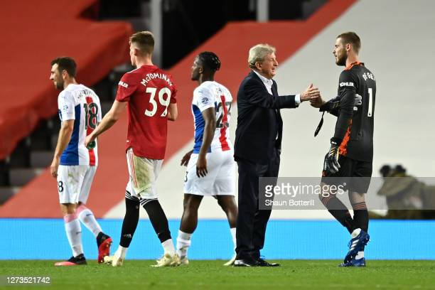 Roy Hodgson Manager of Crystal Palace shakes hands with David De Gea of Manchester United following the Premier League match between Manchester...
