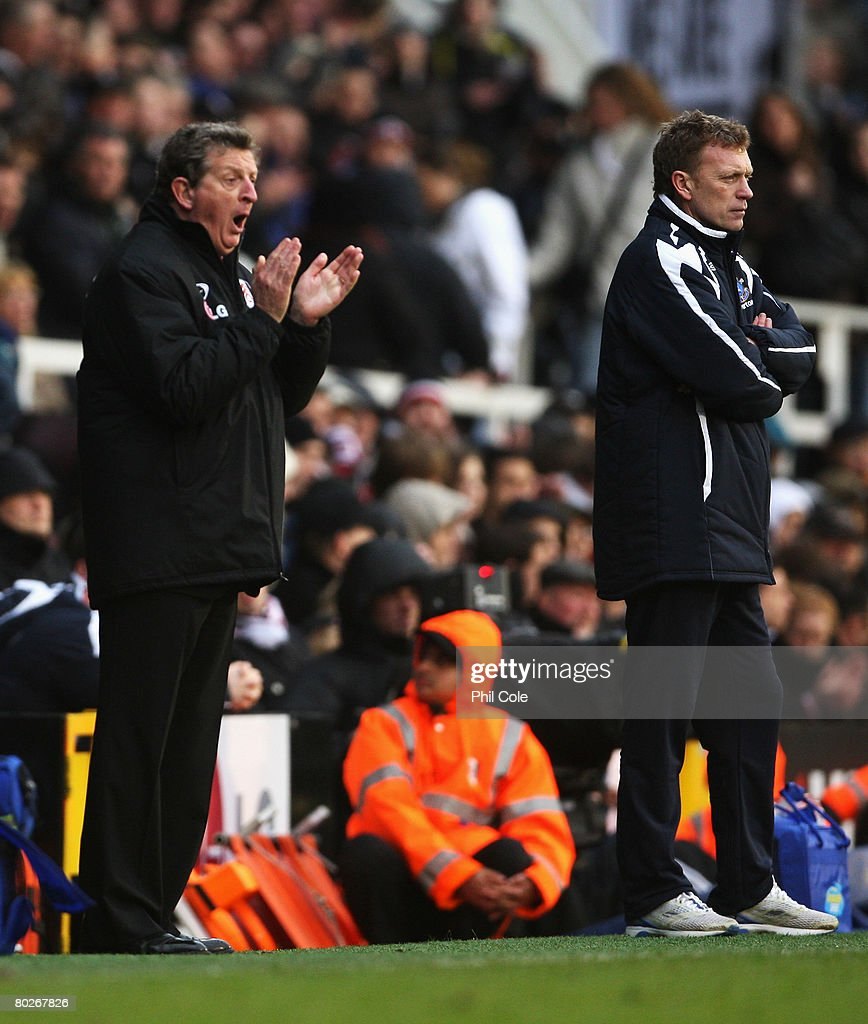 Roy Hodgson, manager of Fulham and David Moyes, manager of Everton look on from the touchline during the Barclays Premier League match between Fulham and Everton at Craven Cottage on March 16, 2008 in London, England.