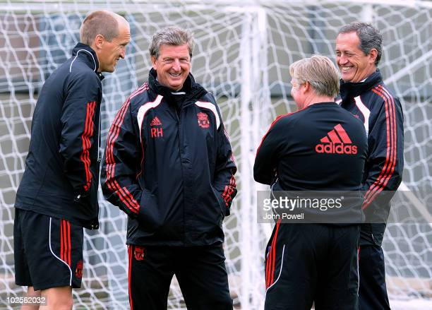 Roy Hodgson manager of Liverpool FC shares a joke with Darren Burgess Head of Fitness and Conditioning Assistant Manager Sammy Lee and Peter Brukner...