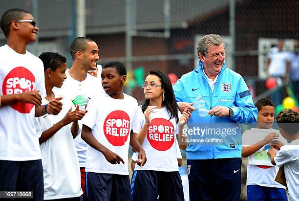 Roy Hodgson of England dances with local children during a visit to a Sport Relief project on May 31 2013 in Rio de Janeiro Brazil