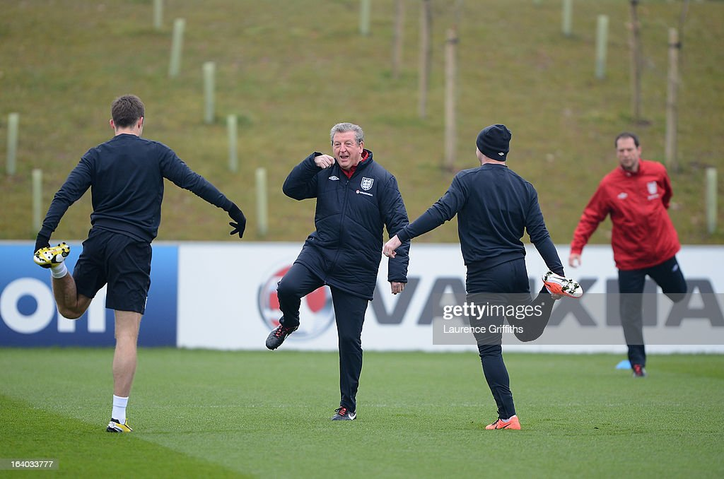 Roy Hodgson of England shares a joke with Wayne Rooney during a training session at St Georges Park on March 19, 2013 in Burton-upon-Trent, England.