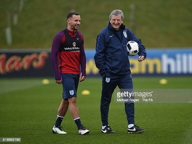 Roy Hodgson of England welcomes Danny Drinkwater of England during England training session and press conference at St Georges Park on March 22, 2016...