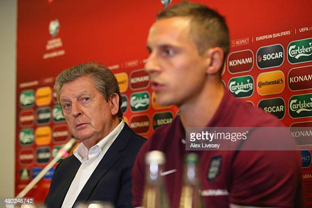 Roy Hodgson the manager of England looks over to Phil Jagielka whom he's made captain for the game against Lituania during a press conference at the...