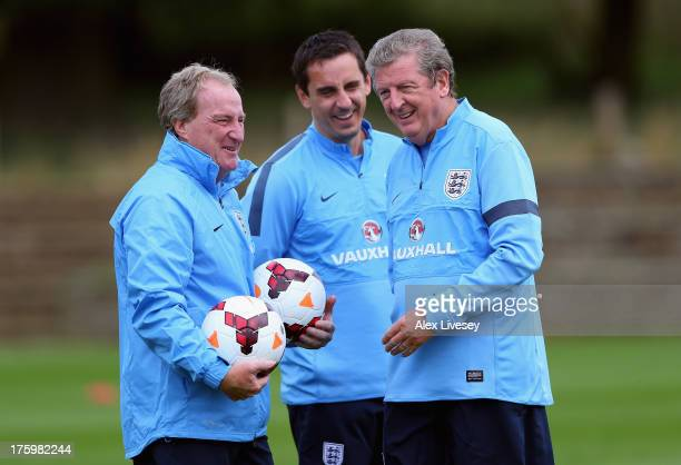 Roy Hodgson the manager of England U21 shares a joke with his assistants Ray Lewington and Gary Neville during a England U21's training session at St...
