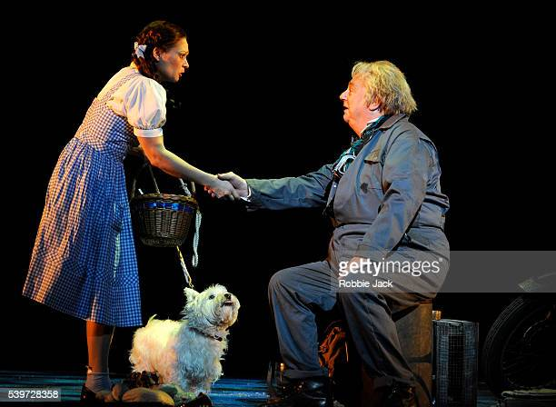 Roy Hudd Sian Brooke and Bobby perform in the production The Wizard of Oz directed by Jude Kelly at the Royal Festival Hall in London