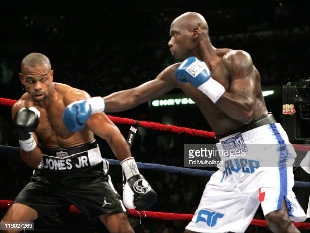 Roy Jones Jr. And Antonio Tarver trade punches during their third fight for the World Light Heavyweight Championship at the St. Pete Times Arena in...