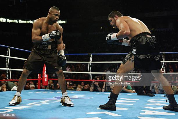 Roy Jones Jr. And John Ruiz stand toe-to-toe during their WBA heavyweight championship bout at the Thomas & Mack Center on March 1, 2003 in Las...