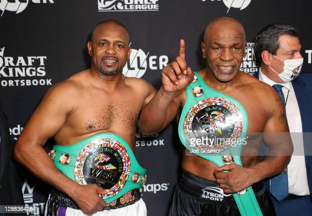 Roy Jones Jr. And Mike Tyson celebrate their split draw during Mike Tyson vs Roy Jones Jr. Presented by Triller at Staples Center on November 28,...