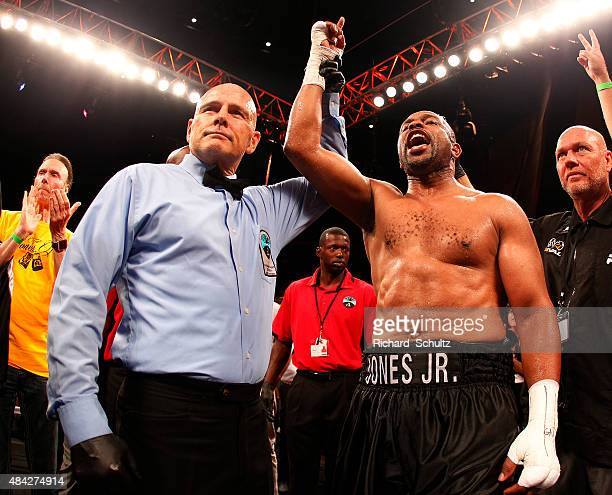 Roy Jones Jr. Has his arm raised by referee Danny Schiavone after knocking Eric Watkins out during the sixth round of their bout in the season two...