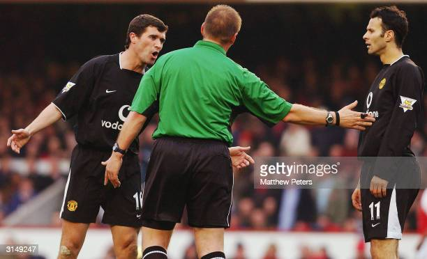 Roy Keane and Ryan Giggs of Manchester United appeal to referee Graham Poll after Giggs was denied a penalty during the FA Barclaycard Premiership...