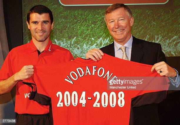 Roy Keane and Sir Alex Ferguson of Manchester United pose with a shirt as Manchester United announced a new sponsorship deal with Vodafone at...