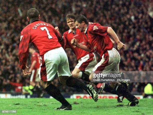 Roy Keane celebrates scoring Manchester Utd's second goal with teammates Eric Cantona and David Beckham in today's Premiership match against...
