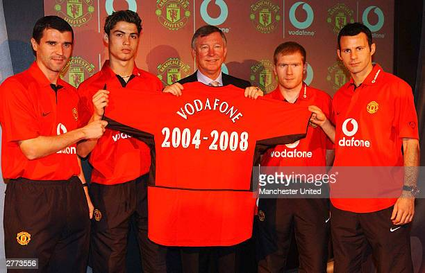 Roy Keane Cristiano Ronaldo Sir Alex Ferguson Paul Scholes and Ryan Giggs of Manchester United pose with a shirt as Manchester United announced a new...