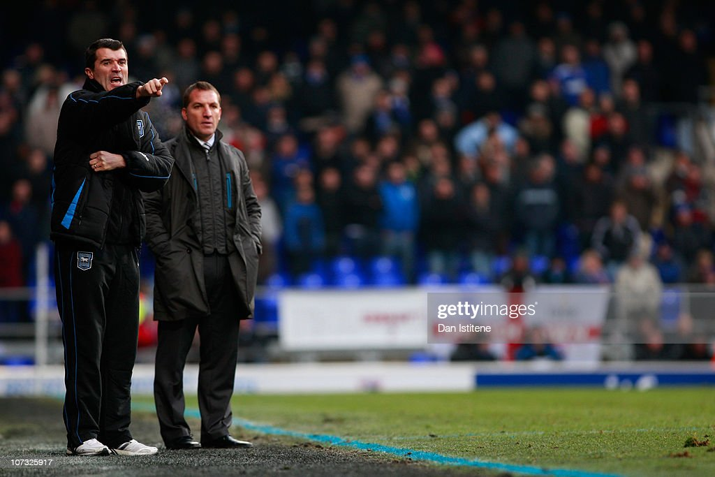 Roy Keane (L) manager of Ipswich issues instructions to his players as Brendan Rodgers manager of Swansea looks on during the npower Championship match between Ipswich Town and Swansea City at Portman Road on December 4, 2010 in Ipswich, England.