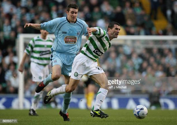 Roy Keane of Celtic is tackled by Kilmarnock's Colin Nish during the Scottish Premier league soccer match at Celtic Park January 14 Glasgow Scotland