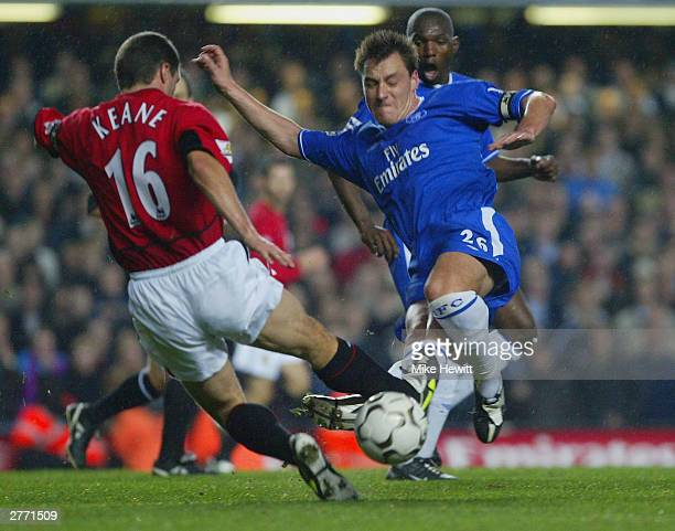 Roy Keane of Manchester United and John Terry of Chelsea both dive in to get the ball during the FA Barclaycard Premiership match between Chelsea and...