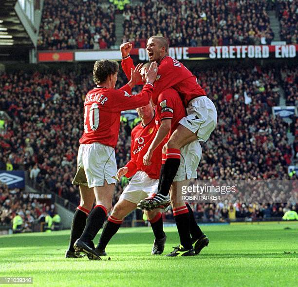 Roy Keane of Manchester united celebrates with teammates Ole Gunnar Solksjaer and David Beckham after scoring the third goal against Arsenal 25...