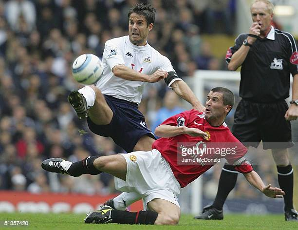 Roy Keane of Manchester United challenges Jamie Redknapp of Spurs during the Barclays Premiership match between Tottenham Hotspur and Manchester...