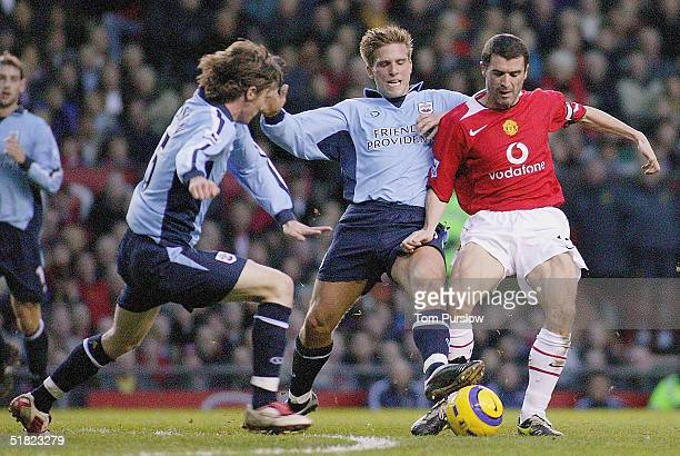 Roy Keane of Manchester United clashes with Anders Svensson of Southampton during the Barclays Premiership match between Manchester United and...