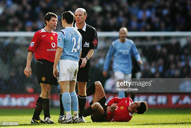 Roy Keane of Manchester United clashes with Joey Barton of Manchester City during the Barclays Premiership match between Manchester City and...