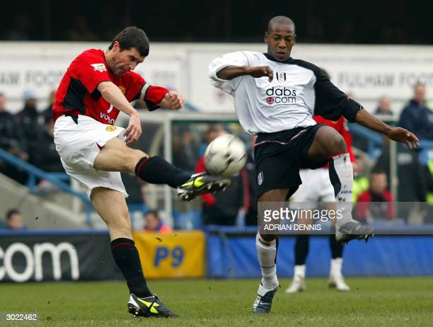 Roy Keane of Manchester United clears the ball from in front of Luis Boa Morte of Fulham during the Premiership football match at Loftus Road in...