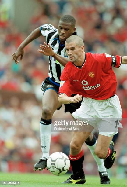 Roy Keane of Manchester United is chased by Carl Cort of Newcastle United during the FA Carling Premiership match between Manchester United and...