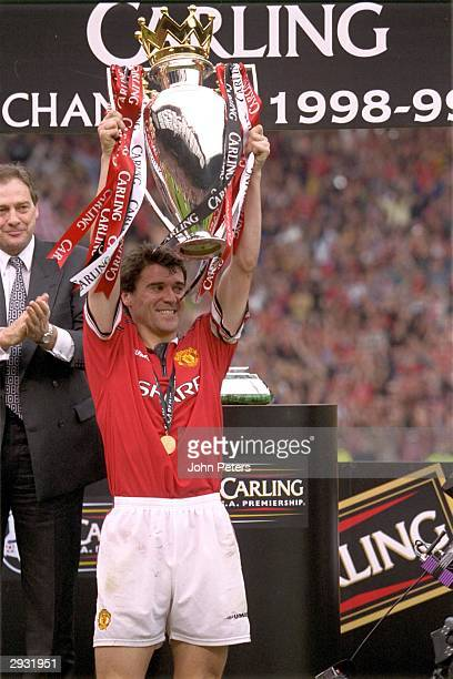 Roy Keane of Manchester United lifts the trophy after the FA Carling Premiership match between Manchester United v Tottenham Hotspur at Old Trafford...