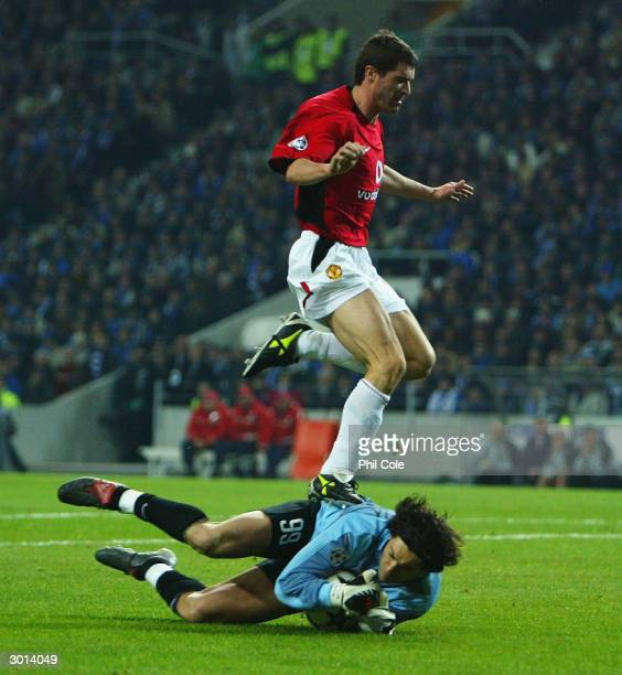 Roy Keane of Manchester United makes contact with the goalkeeper Vitor Baia of FC Porto in a sending off offence during the UEFA Champions League...